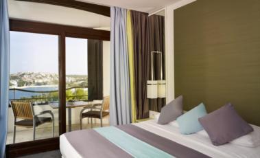 Dvokrevetna soba suite strana more sa balkonom s noćenjem i doručkom