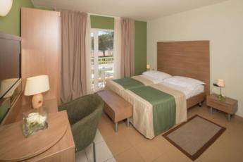Dvokrevetna soba, premium, strana bazen sa balkonom i polupansionom