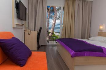Dvokrevetna soba, mala, na strani more sa polupansionom
